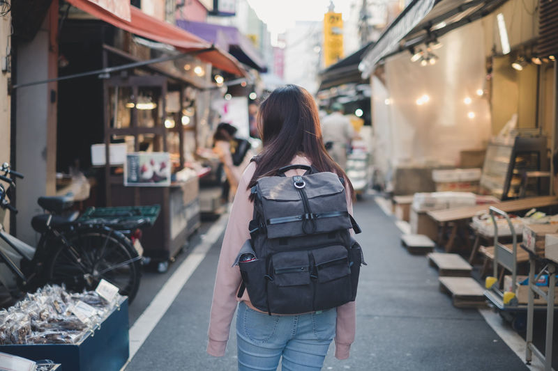 Back side of Asian woman with backpack travelling in market shopping landmark in old city on holiday Street Tourist Travel Asian  Woman People Thailand Background Bangkok Holiday City ASIA Road Market Back Traveler Backpacker Young Outdoor Tourism Vacation Southeast Thai Trip Bag Town Walk Lifestyle Female Girl Happy Summer Standing Sightseeing Backpack View Beautiful Tourists Rucksack Luggage Rear Japan Shopping Old Adventure Journey Seeking Leisure Outside