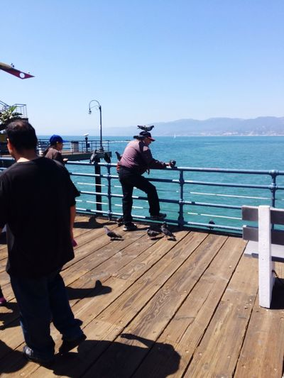 Birds on the Santa Monica Pier Santa Monica Birds Clear Sky Full Length Water Lifestyles Leisure Activity Men Railing Casual Clothing Pier Blue Day Plank Person Sea Weekend Activities Flying