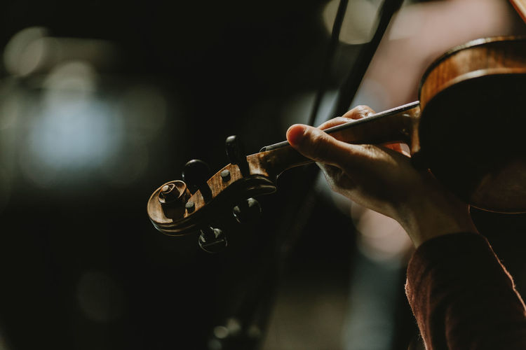 Close up violinist holding violin