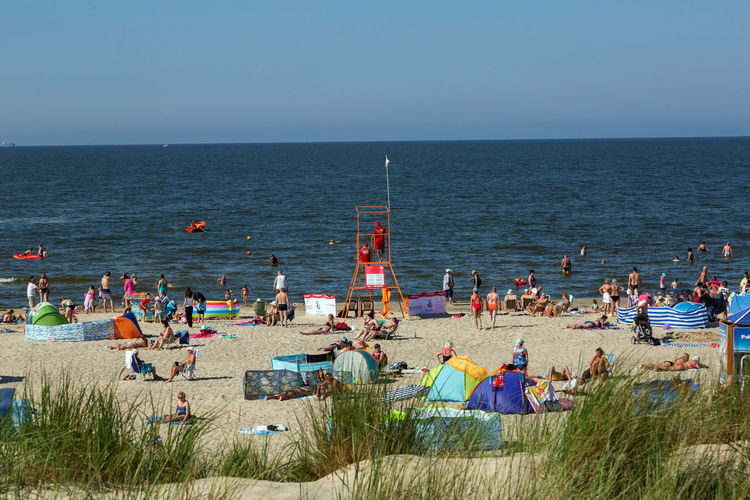 Baltic Sea Beach Crowd Group Of People Holiday Horizon Horizon Over Water Land Large Group Of People Leisure Activity Lifestyles Nature Outdoors Real People Relaxation Sea Sky Trip Vacations Water
