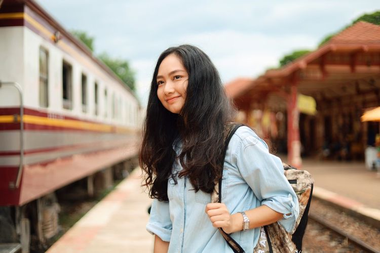 Young Adult One Person Young Women Standing Focus On Foreground Long Hair Rail Transportation Architecture Adult Casual Clothing Railroad Station Platform Hairstyle Hair Women Beauty Train Railroad Station Real People Waist Up Beautiful Woman Track Outdoors