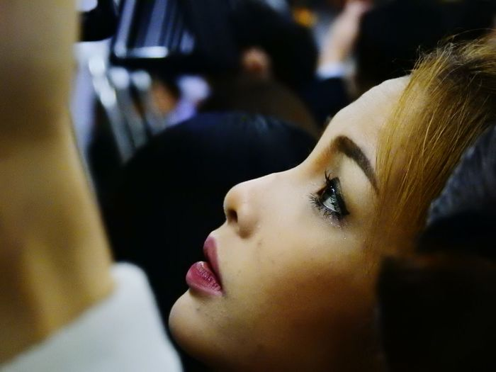 Close-Up Of Young Woman In Subway Train