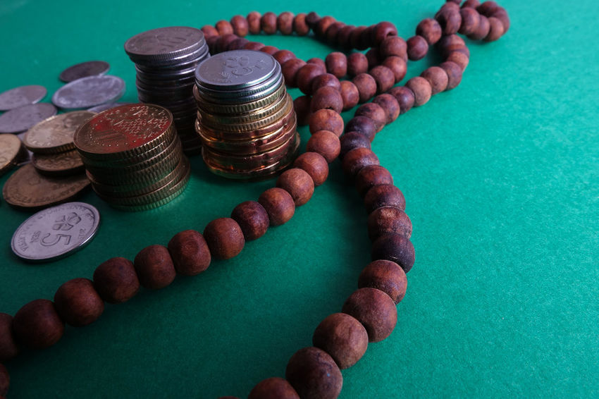 Islamic Banking/Financing Conceptual with rosary and coins on a green background. Rosary Abundance Coins Economic Finance Green Background Islamic Banking Islamic Financing