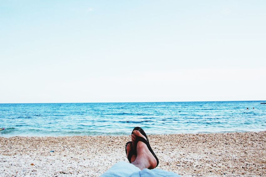 Low Section Water Sea Clear Sky Beach Sand Relaxation Blue Women Human Leg Human Foot Legs Crossed At Ankle Flip-flop Calm Beach Holiday The Traveler - 2018 EyeEm Awards The Great Outdoors - 2018 EyeEm Awards