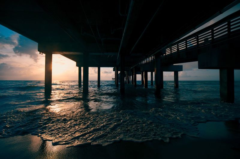 Pier over sea during sunset