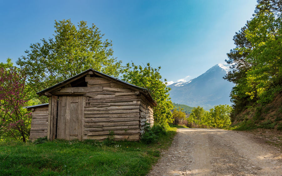 Albania Barn Rural Abandoned Architecture Beauty In Nature Building Building Exterior Built Structure Day Grass Green Color House Hut Landscape Mountain Nature Outdoors Rural Scene Scenics - Nature Shelter Sky Tree Wood - Material