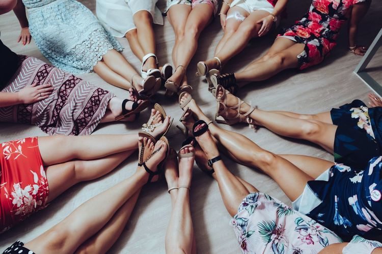 Lovely Legs Large Group Of People Togetherness Celebration Human Body Part Only Women Women Human Hand Unity People Teamwork Day Real People Sitting Adult Low Section Friendship Adults Only Outdoors Bride