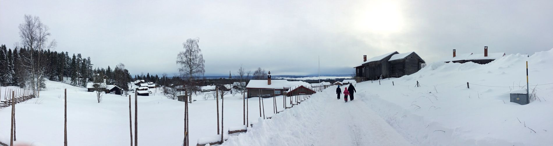 Panoramic view of snow covered field against sky