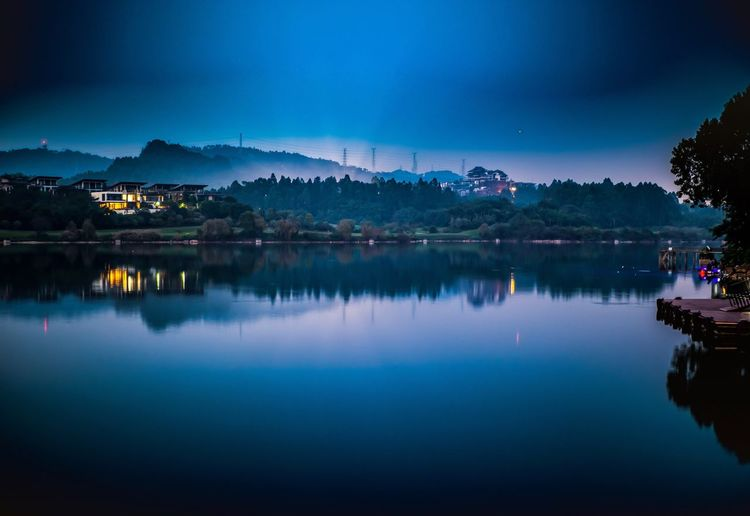Baiyun lake side Reflection Blue Sky Tranquil Scene Scenics Nature Water Night Tranquility No People Outdoors Beauty In Nature Built Structure Building Exterior Architecture Illuminated Mountain Landscape Nautical Vessel Tree Baiyun Lake Side Guangzhou China Low Light Photography