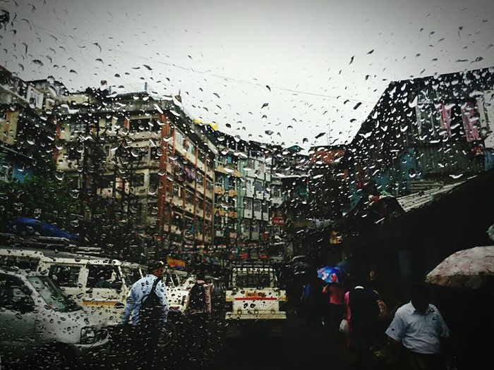 Rain in Darjeeling.. Place to beat the heat. Wet Architecture Drop Built Structure Window Building Exterior Street Car City Water Day Large Group Of People Outdoors Sky People Tree Adult Adults Only Darjeeling India DARJEELING BEAUTY Darjeeling Himalayas Darjeeling Nature Rainy Days Darjeelingdiaries Rain Drops