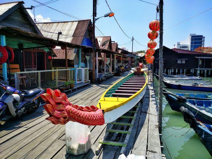 Boats moored at dock
