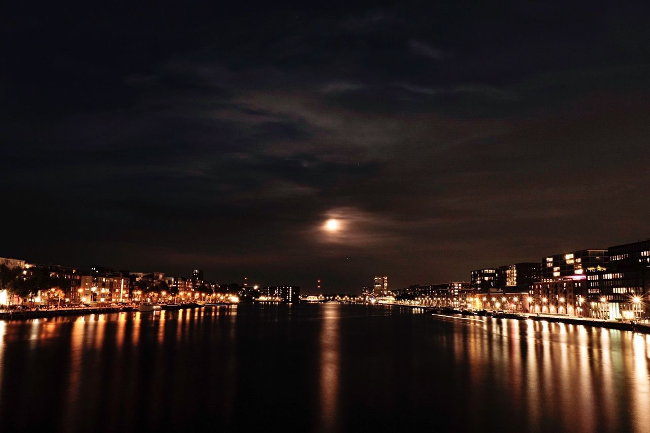 night, illuminated, architecture, building exterior, city, built structure, sky, cityscape, reflection, river, water, no people, waterfront, moon, outdoors, skyscraper, nature