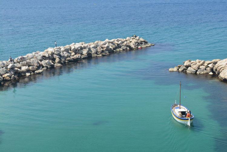 High angle view of groyne in sea
