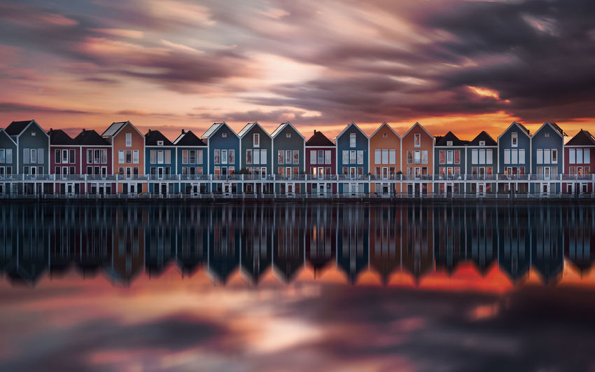 EyeEm Best Shots Remo SCarfo Architecture Beauty In Nature Building Building Exterior Built Structure Cloud - Sky Dramatic Sky Dusk Dutch Holland Nature No People Orange Color Outdoors Reflection Scenics - Nature Sea Sky Sunset Water Waterfront