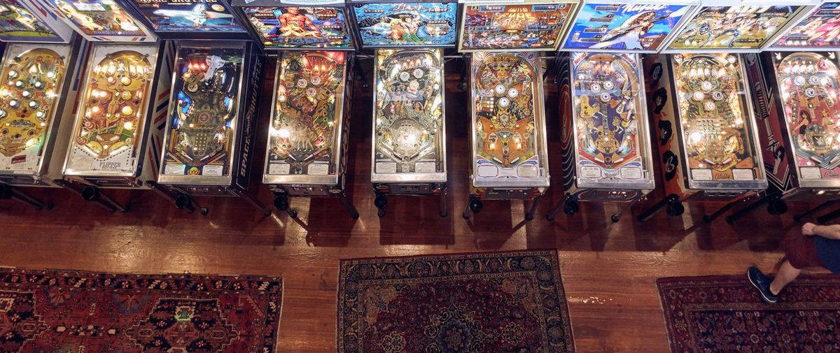 Indoors  Choice In A Row Variation Retail  Text No People Human Representation Abundance Flooring Panoramic Large Group Of Objects Arrangement Store Representation Multi Colored Glass - Material Table Food And Drink Male Likeness Pinball Arcade Games