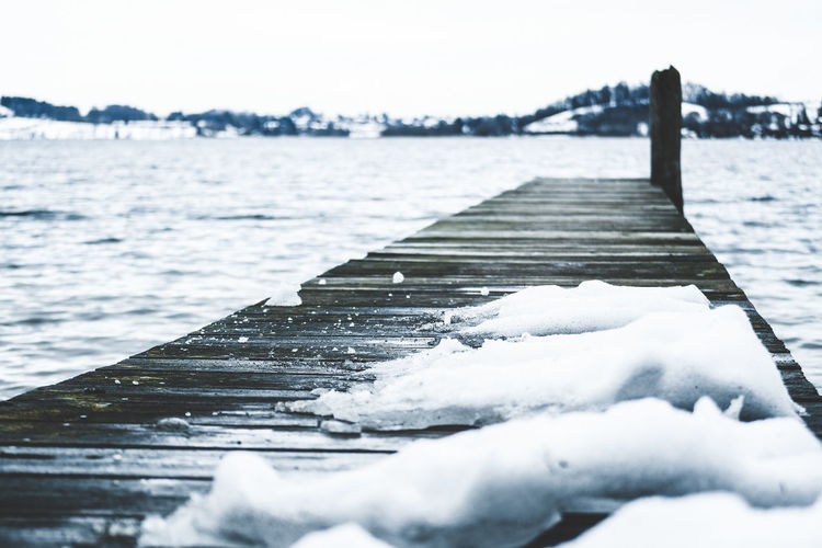 snow covered Water Nature Day Winter Cold Temperature Snow Outdoors No People Footbridge Footbridge Crossing Landing Stage Snowcapped Snow Covered Lake Winter Wooden Stage Wooden Bridge Icy Frozen Sliding Slip On Ice Ice Slide Dangerous Slipping