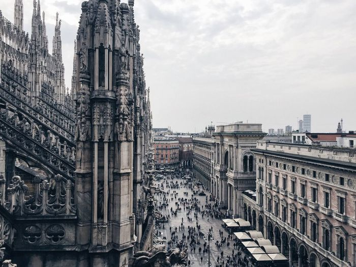 People At Town Square By Duomo Di Milano Against Sky