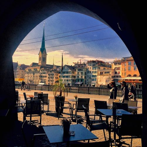 A sidewalk cafe in Zurich, Switzerland. Framing the lovely scene beyond the arches... LLLimages CaughtintheFrame Zurich, Switzerland Showcase March