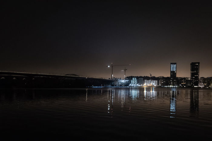 Architecture Beauty In Nature Building Exterior City Cold Temperature Construction Site Dark Darkness Illuminated Lake Nature Night Night Lights Night Photography Welcome To Black Outdoors Reflection Sky Skyline Urban Nature Water Waterfront Winter Årstabron Årstaviken