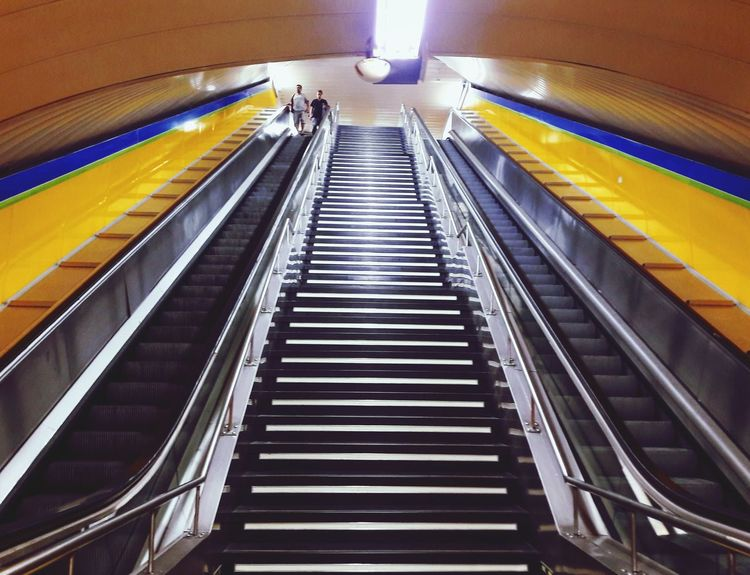 Underground Subway Stairs Metro #MetrodeMadrid Simetry #madrid SPAIN Yellow Somepics Illuminated Modern Technology Futuristic Convenience Steps And Staircases Steps Staircase Railing Architecture