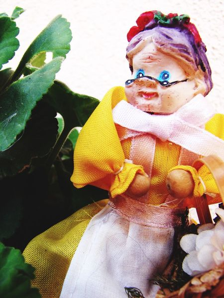 grand mother doll in yellow sitting outdoor Doll Grand Mother Aging Society Aged Person Concern Generation
