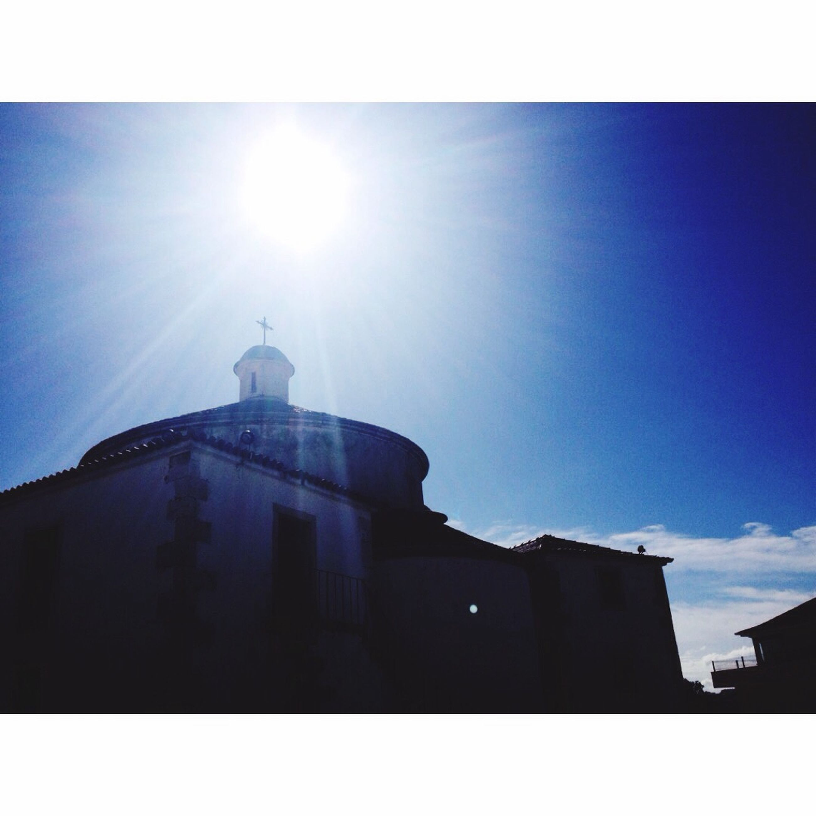 building exterior, architecture, built structure, transfer print, low angle view, church, auto post production filter, religion, place of worship, sky, spirituality, blue, sun, dome, sunlight, clear sky, silhouette, sunbeam