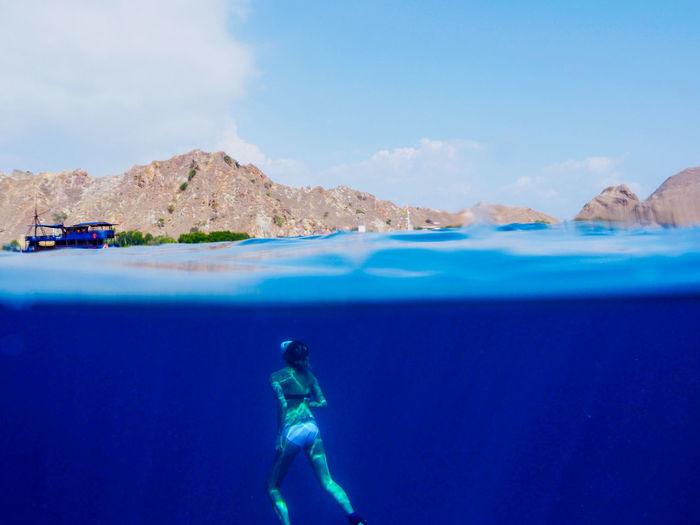 Alone Beauty In Nature Blue Deep Diving GH4 Half HalfNHalf Islands Mermaid Mountain Mountain Range Nature Ocean Panasonic  Sea Sky Snorkeling Sunbeam Swimming Travel Underwater Vacations Woman