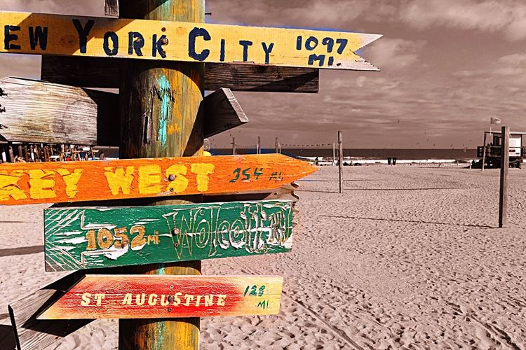 I don't need a GPS device or Google Map when I'm on this beach. Taking Photos Hello World Relaxing Travel Photography Ocean View Beach Signs Florida Life Colorful Fun Directional Sign Direction Sand Black And White Black With A Splash Of Color