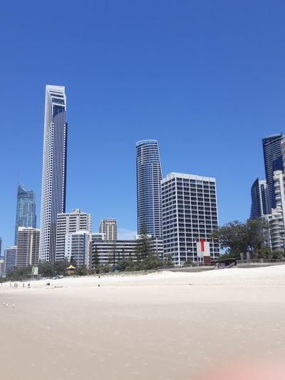 Skyscraper Beach Sand Modern Architecture City Clear Sky Sky Urban Skyline Building Exterior No People