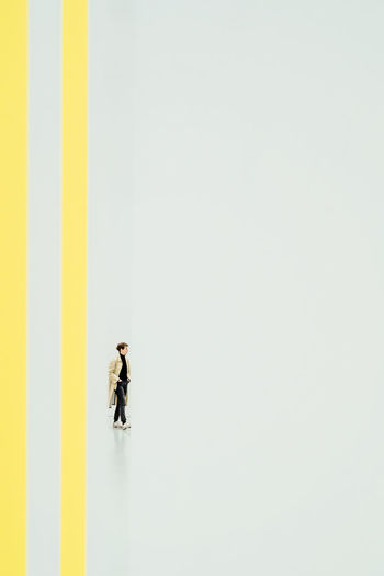 Man and woman walking on white background