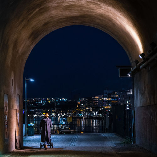 Building Exterior Architecture Illuminated City Built Structure Night Building Outdoors Södermalm Hammarby Sjöstad Night Shot Night Lights Arch Real People Rear View Street Full Length The Way Forward Direction Arched One Person Lifestyles Leisure Activity Mother Woman Moms & Dads