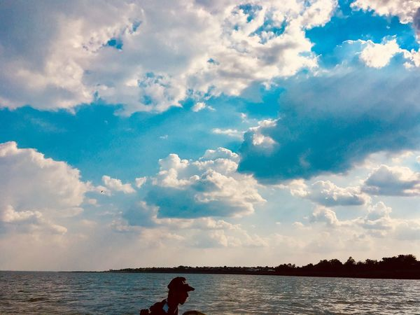 Sky Cloud - Sky Water Beauty In Nature Real People Nature Leisure Activity Tranquil Scene Tranquility Scenics - Nature Lifestyles Waterfront One Person Rear View Day Outdoors Women Sea