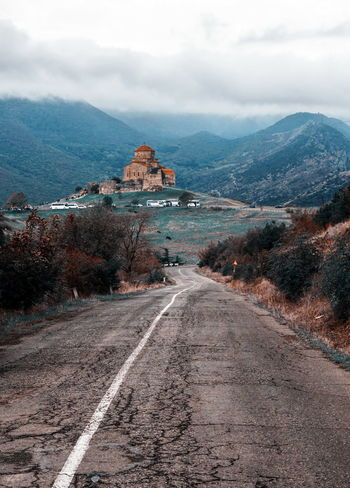 Georgia Jvari Monastery Architecture Cloud - Sky Day Diminishing Perspective Direction Environment Landscape Mountain Mountain Range Nature No People Outdoors Road Scenics - Nature Sign Sky Symbol The Way Forward Transportation Travel Travel Destinations
