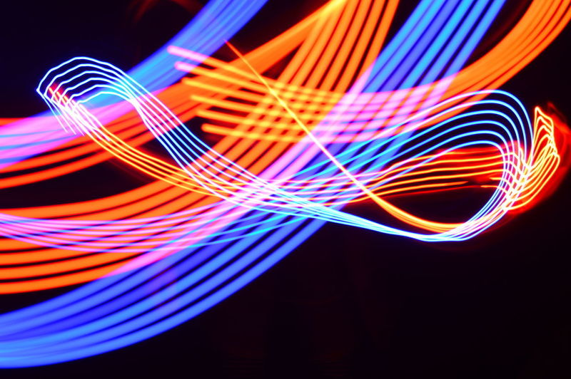 Multi colored light painting against black background