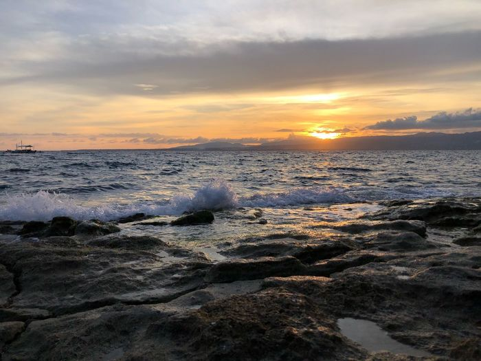 ApoIsland BeachSunset Sunsetphotographs Sunset Sunset Sky Water Sea Beauty In Nature Scenics - Nature Beach