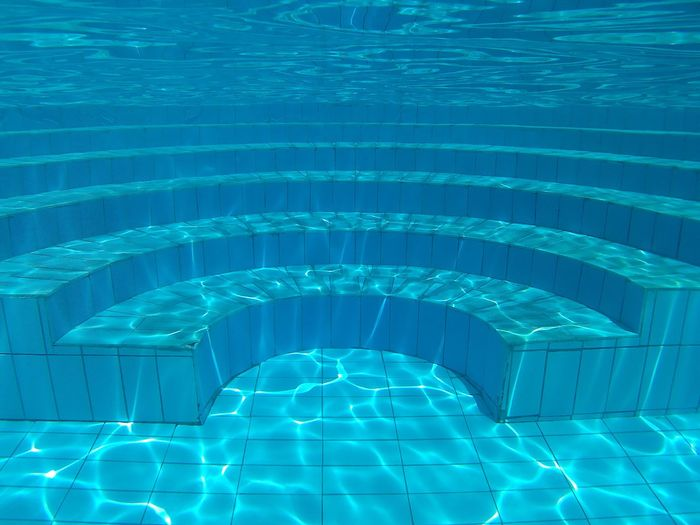 Steps in blue swimming pool