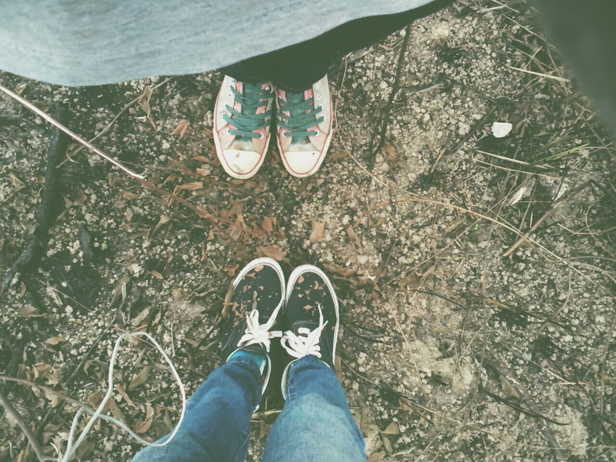 low section, person, shoe, personal perspective, lifestyles, high angle view, leisure activity, standing, human foot, footwear, men, water, unrecognizable person, jeans, day, outdoors, part of