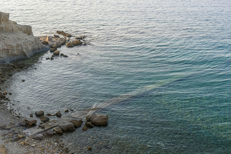Water Sea Rock High Angle View Beauty In Nature Tranquility Solid Rock - Object Nature Day Scenics - Nature No People Tranquil Scene Outdoors Beach Land Motion Rippled Idyllic Groyne