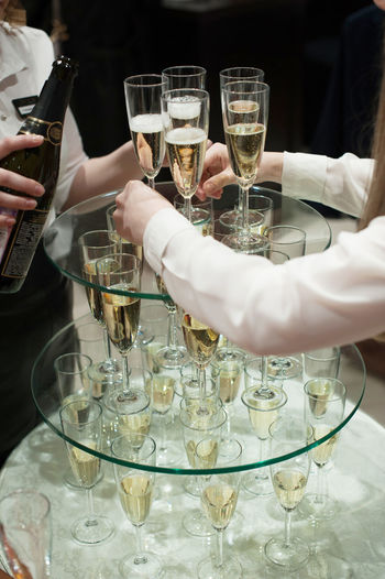 Cropped Hands Holding Champagne Flute Table