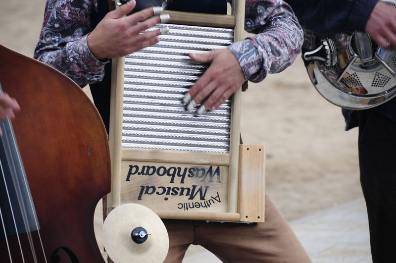 Musical Instrument Music Human Hand Real People Hand Midsection Musical Equipment Arts Culture And Entertainment Human Body Part Musician Playing People Holding Artist Day Men Performance Drum - Percussion Instrument String Instrument Finger Music Concert Street Musician Analogue Sound The Art Of Street Photography