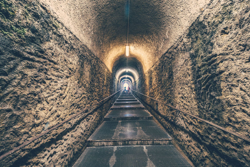 A long stair way in a tunnel that we walked up when visiting Herculaneum in Italy Fujifilm Herculaneum Italia Italy Symmetrical Symmetry Tunnel Tunnel Vision Vanishing Point X-Pro1