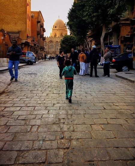 Egypt Cairo Elhussien Streetphotography Outdoors Street Architecture Walking City Cobblestone Built Structure Building Exterior Full Length Large Group Of People People Adult Adults Only EyeEm Best Shots EyeEmNewHere EyeEm Gallery Eyeemphotography Day Vscocam VSCO Week On Eyeem