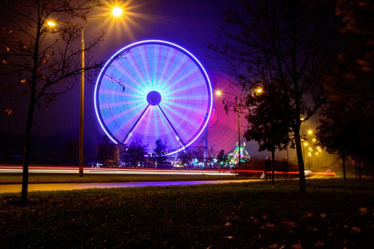 Amusement Park Carousel Ferris Wheel Illuminated Light Trail Long Exposure Night No People Outdoors Street Light