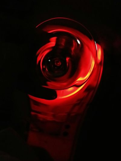 Close-up of red light against black background