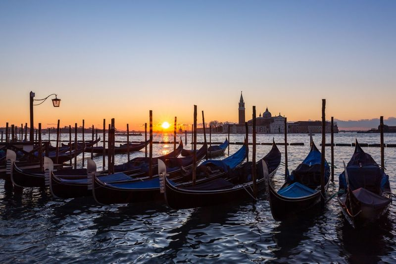 Venice at sunrise Sunburst Venezia Venice, Italy Romantic Attractions Scenery Spectacular Boats Canals Waterways Veneto Region Adriatic Sea Lagoon Water Sky Nautical Vessel Mode Of Transportation Gondola - Traditional Boat Transportation Travel Destinations Nature Building Exterior Waterfront Travel Architecture No People Canal Wooden Post Capture Tomorrow 2018 In One Photograph The Great Outdoors - 2019 EyeEm Awards