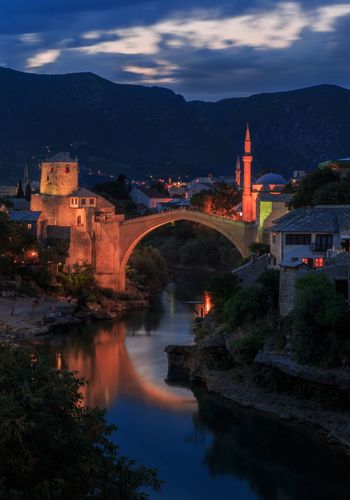 Sunset of old town Mostar Bosnia And Herzegovina Mostar Old Town Night Lights Nightphotography Sunset Architecture Bridge - Man Made Structure Built Structure Connection Arch Sky Water Cloud - Sky No People History Building Exterior River Nature Outdoors Mountain Travel Destinations Transportation Illuminated Night Scenics