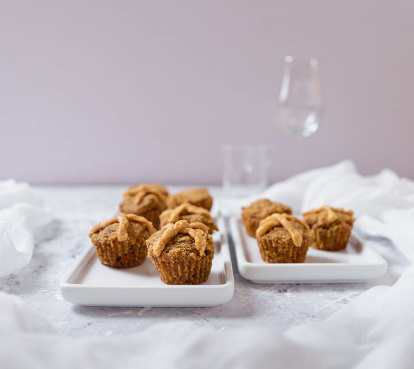 Cupcakes Eating Hot Cross Buns Snack Breakfast Brightly Lit Close-up Cupcake Eating Healthy Focus On Foreground Food Food And Drink Freshness Indulgence Muffin Muffins Ready-to-eat Selective Focus Snack Sweet Food Table Temptation