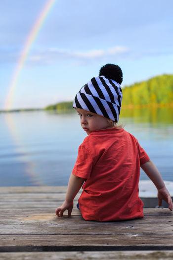 Boy looking at river