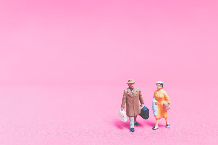 Miniature people : Couple of travellers on pink background , Valentine's day concept Background Backpack Backpacker Closeup Concept Creative Destination Exploration Figure Guide Holiday Journey Macro Map Mini Miniature People person Pink Plan Small Tiny Tour Tourist Toy Travel Traveler Trip Vacation Valentine Walking World