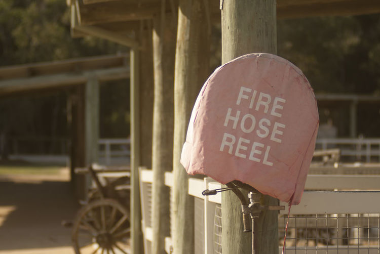Close-Up Of Information Sign On Fire Hose
